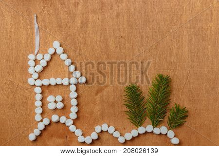 small house in the forest full of snowdrifts. Flat lay