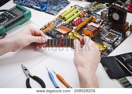 Technician upgrade of computer close up. Engineer pov, renovation microchip component in motherboard. Maintenance support and repairing service concept.