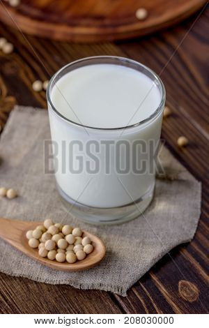 Soy milk with soy beans around it