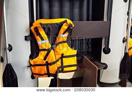 Personal Flotation Device As Life Jacket And Boat In Store