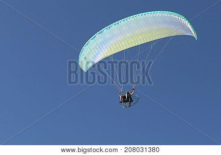 Corpus Christi, Texas - October 7, 2017: Paraglider on Blue Sky