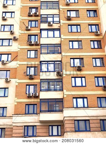 Vertical image of the facade of a residential building.