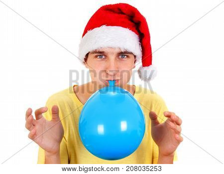 Young Man in Santa Hat inflate a Blue Balloon on the White Background