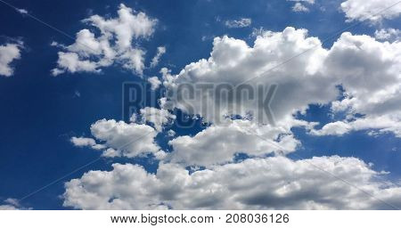 beautiful blue sky with clouds background.Sky clouds.Sky with clouds weather nature cloud blue.Blue sky with clouds and sun