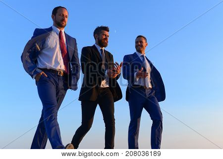 Company Leaders Take A Walk On Sunset Sky Background