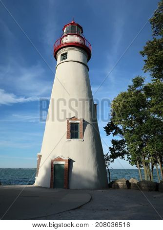 The Marblehead Light, seen here in early evening, is the oldest lighthouse in continuous operation on the Great Lakes. It was built in 1821 on the south shore of Lake Erie in Marblehead, Ohio.