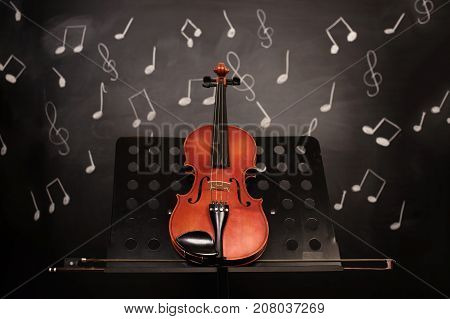 classic old violin and notes.Music instruments background.
