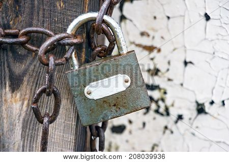 Old Closed lock on the chain. Water droplets are visible on the lock