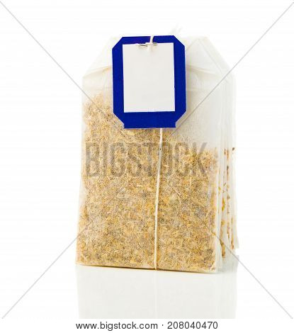 a bag of chamomile tea on a white background