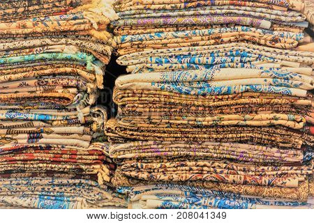 Colorful rugs and towels on a stack in Iranian Bazaar