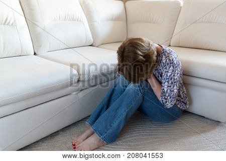 Woman crying covering her face with a hands