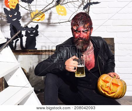 Demon With Horns And Evil Face Holds Jack O Lantern
