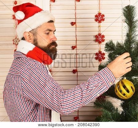 Santa Claus With Serious Face On Red Holiday Garlands Background.