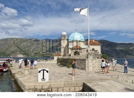 MONTENEGRO, PERAST - AUGUST 13, 2017: Temple of the Our Lady of the Rocks in located on the man-made island in the Bay of Kotor 1630