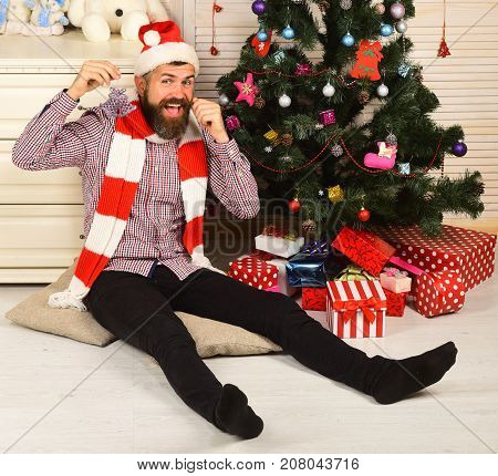Man With Beard Holds Purple Decoration. Celebration And Decor Concept