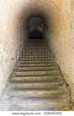 Old stone staircase leading to the basement. Casemates of abandoned military fortified fortification. Fort Tarakanivsky. Dubno. Ukraine