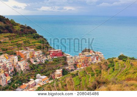 Panoramic view of Manarola small village on the coast in the province of La Spezia northern Italy - Cinque Terre.