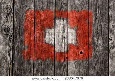 swiss flag on old wooden planks background