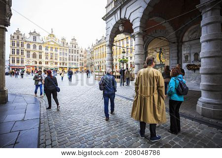 BRUSSELS BELGIUM - JUNE 18 2016: Picture of the entrance to the Grand Place with many tourists in a cloudy day. Brussels Belgium.