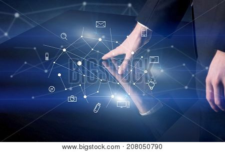 Male hands touching interactive table with blue mixed communication icons in the background