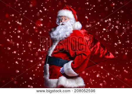 Christmas concept. Portrait of a fairytale Santa Claus over red background. Good old traditions. Family holidays.