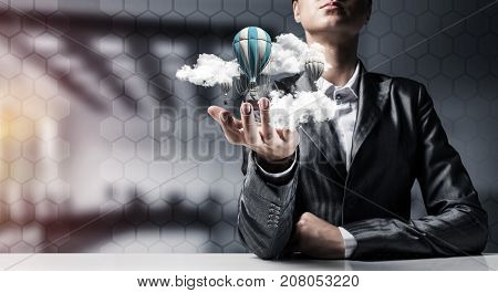 Closeup of business woman in suit presenting flying aerostate among clouds in her palm with office view on background. 3D rendering.