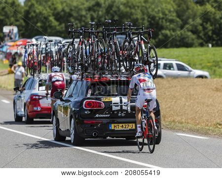 Mailleroncourt-Saint-Pancras France - July 5 2017: Rear image of the French cyclist Rudy Molard riding behind a technical car on a road to La Planche des Belle Filles during the stage 5 of Tour de France 2017.