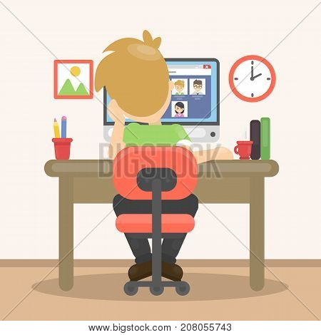 Man with computer. Young bored man sitting at the table and using computer.