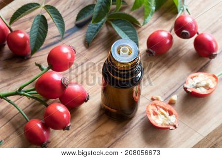 A Bottle Of Rose Hip Seed Oil On A Wooden Table