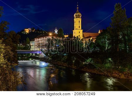 GRAZ, AUSTRIA - JULI 17, 2017: Mur river and Franciscan Church in Graz, Austria. Old town of Graz is the UNESCO World heritage.