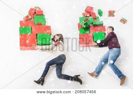 Mom and father holds many gifts for their childrens, kids. Christmas shopping. New Year 2018