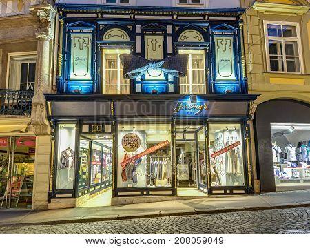 GRAZ, AUSTRIA - JULI 17, 2017: Fasion strore exterior at night in Graz, Austria.Old town of Graz is the UNESCO World heritage.