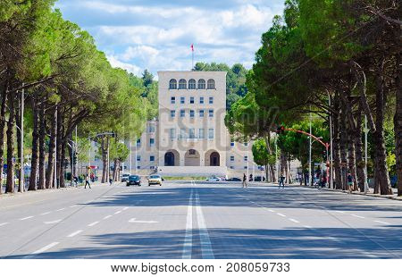 TIRANA ALBANIA - SEPTEMBER 6 2017: Unknown people walk along boulevard of Martyrs near Polytechnic University of Tirana Albania