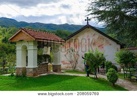 MONASTERY OF MORACA MONTENEGRO - SEPTEMBER 12 2017: Unknown tourists visit Church of St. Nicholas and belfry in Monastery of Moraca Montenegro