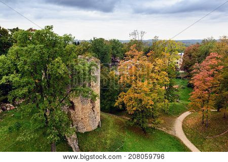 Aerial view on autumn park with old tower ruins in Cesis town, Latvia