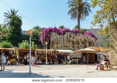 RHODES, GREECE - AUGUST 2017: Small souvenir shops near old fortress walls at Rhodes town on Rhodes island, Greece
