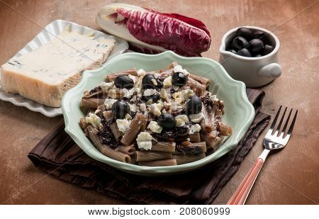 integral pasta with red chicory gorgonzola black olives and almond