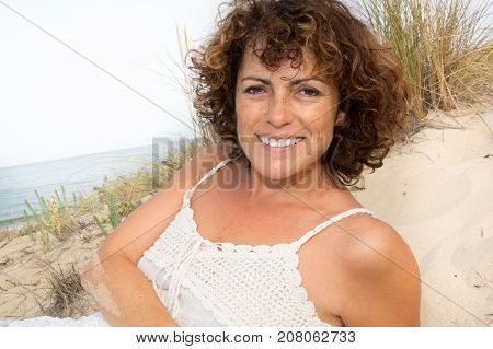 Happy Woman At The Beach Enjoying Her Summer Holidays