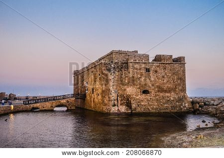 view on medieval castle at sunset in Pafos, Cyprus