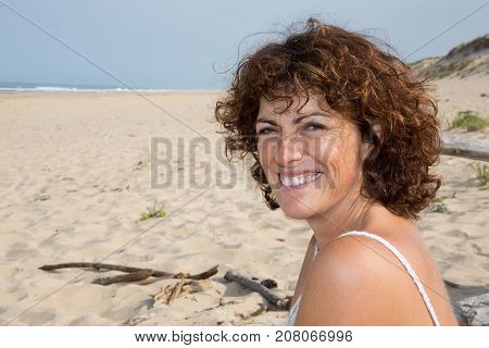 Beautiful Woman Relaxing On Tropical Sand Beach, Sky And Sea Background