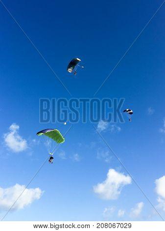 Three skydivers in the sky, Cuba, Varadero