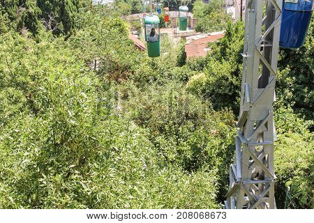 Yalta, Crimea - 11 July, Plum under the cable car, 11 July, 2017. City views of Yalta from the height of the cable car.
