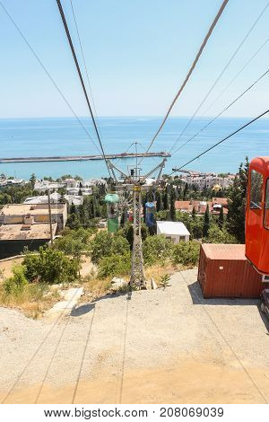 Yalta, Crimea - 11 July, Cable car to the sea, 11 July, 2017. City views of Yalta from the height of the cable car.