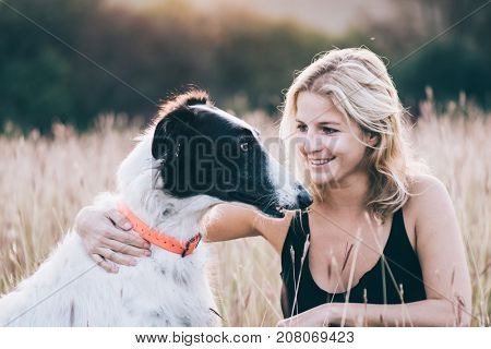 Happy woman with her dog outdoor
