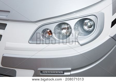 Closeup Point On Headlight Lamp Car Front Light Of Van Or Truck