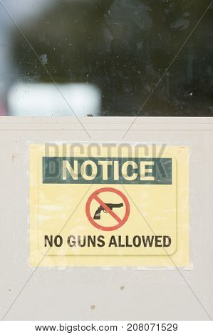 a No Guns allowed sign on the wall at the entrance.