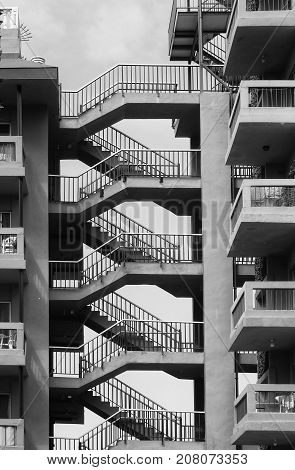 old concrete apartments onan estate with connecting stairs and walkways