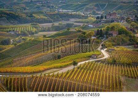 Grinzane Cavour castle in langhe region of northern italy in autumn with full bright colors