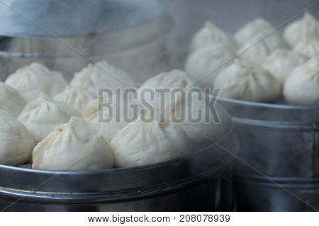 steaming chinese steamed bread in the steamer