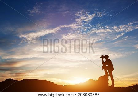 Man standing on rocks, looking through binoculars. Looking forward into the future. Sunset scenic sky. 3d illustration.